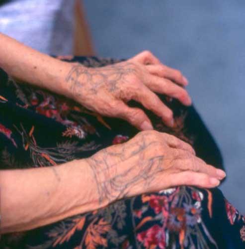 The last tattoos of st lawrence alaska lars krutak for Tattoo of ak